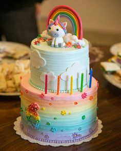 Unicorn and rainbow birthday cake #rainbow #unicorn #clouds #birthday cake# #cake #buttercream #fondant decorations