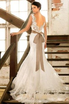 Wedding dress with taupe sash.