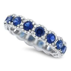 14 karat white gold sapphire ring with carat total weight in diamond for the halos surrounding the sapphires SKU: White Gold Sapphire Ring, Sapphire Eternity Ring, Sapphire Band, Sapphire Bracelet, Sapphire Jewelry, Eternity Bands, Blue Sapphire, Sapphire Anniversary, Anniversary Rings