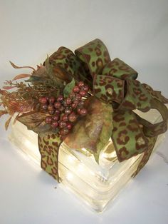 Glass block with light inside + A green, brown and gold cheetah print ribbon --- sweet presentation for the perfect gift
