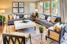 could use gray couches with yellow and blue pillows and add more interesting decor