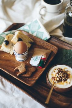 breakfast in bed: grape ricotta focaccia (recipe coming soon!), an egg, dala horse cookies, tabasco, maldon salt, yogurt with nuts and honey, green juice, a nell & mary napkin, a little gold spoon, and obviously coffee.