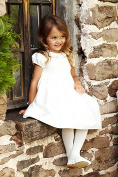 Instead of white tights do the colors of your wedding in that. If you have two girls have one wear the other color. Such a cute dress.