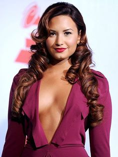 Latin Grammys - Demi Lovato thick ringlets, curled bangs and red lips | allure.com