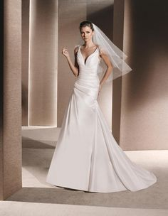 ROMY 2016 LA SPOSA  A-line dress in draped dupion. Bodice with V-neck and straps embellished with gemstone embroidery on the shoulders.