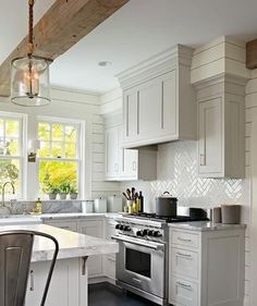 The exposed wood beam is like icing on the cake! #kitchen #kitcheninspo #interiordesign #interdecor #whitekitchen #woodbeam #herringbonetile photo via my Pinterest page kitchens pinned by DecorPad.
