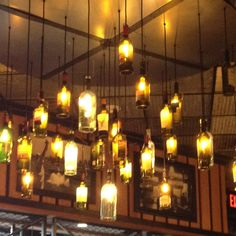 Wine bottle chandelier. Cut the bottoms off and stick a light in!