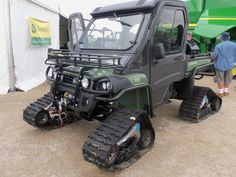 John Deere Gator 825i.The tracks on this Gator are brand new according to the JD guy we talked to here