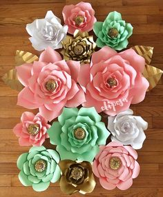 Handmade paper flowers. Can be used as a backdrop for any type of event or as a statement piece in the home or retail boutique. This listing is for a