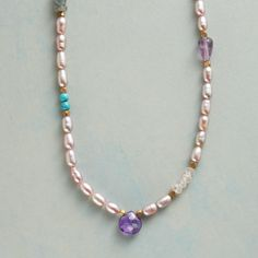 """VIOLETS AND BLUES NECKLACE--An amethyst briolette centers violet tinted cultured pearls, sparked with brass beads and lapis, moonstone, iolite, labradorite, turquoise, and rose quartz. Sterling silver lobster clasp. Exclusive necklace handmade in USA. 17""""L."""