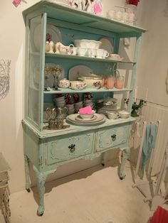 Shabby Chic Cottage Decor - Removing the doors from a china hutch makes the contents easily accessible.   If I had an antiques or craft store, I would display things this way!