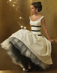 White poofy dress with 3 black bands at the torso, and white and black tulle under the skirt!!! Too cute, for sure!