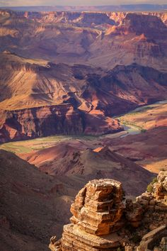 The Grand Canyon, & the dramatic beauty of its landscape in beautiful desert hues of reddish-brown colors!