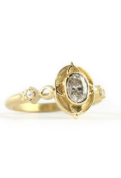 """Brides.com: . """"Arcada"""" ring in 18K yellow gold with a 0.4 ct oval diamond, $3,300, Megan Thorne"""
