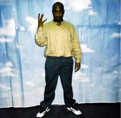 Rare Polaroid of Tupac Shakur representing the #WestCoast with his iconic 'W' symbol.