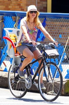 Actress Naomi Watts wins the look when donning on the Twenty8Twelve T-shirt. She really gets a touch of the fashion with her bicycling.