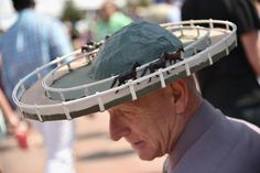 Man with a hat during the 142nd running of the Kentucky Oaks horse race at Churchill Downs on May 7, 2016, in Louisville, Ky.