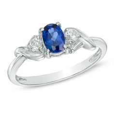 Emily Rates: Not my fav, but I would go for this. On sale at Zales!  Oval Lab-Created Blue Sapphire and White Topaz Ring in 10K White Gold