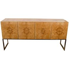 Midcentury Milo Baughman Burled Olivewood Cabinet or Sideboard | From a unique collection of antique and modern sideboards at https://www.1stdibs.com/furniture/storage-case-pieces/sideboards/