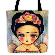 A beautiful tote bag featuring Frida Kahlo, imagined by Danita Art in a colorful image with feathered bird wings, because who needs feet when you have wings to fly. - $22.00, available at danitaart.com