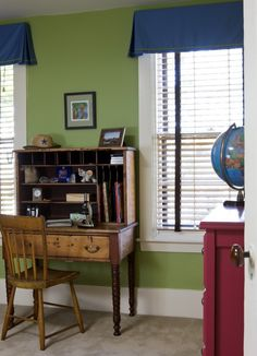 like this color green for walls. red dresser and blue curtains.  could work for boys shared room with blue bunk