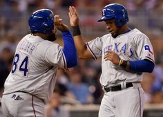 Prince Fielder #84 and Elvis Andrus #1 of the Texas Rangers celebrate scoring against the Minnesota Twins during the seventh inning on July 1, 2016 at Target Field in Minneapolis, Minnesota. The Rangers defeated the Twins 3-2 in ten innings. (Photo by Hannah Foslien/Getty Images)