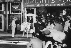 "Marilyn on the set of ""The Seven Year Itch"" 1954 filming the scene with the white dress in the wind. Crowd was watching"