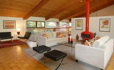 mid century living room with freestanding fireplace