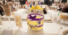 Wedding theme: Lovebirds  Wedding colours: purple & yellow    A birdcage for the wishing cards