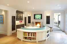Paul Davis New York: Modern dining area with semi circular booth seating and wall to wall white subway tile. ...
