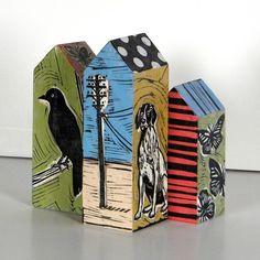 Blocks of wood with an original linoleum block print on each side by Lisa Kesler - could papier mache tetra packs to print onto