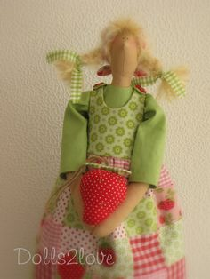 Tilda doll Mila wearing a patchwork pinafore dress от Dolls2love