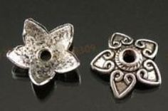 Tibetan Silver Antique Flower 13mm Bead End Caps   Perfect accent for your beading project; just add these really nice bead caps for a more Victorian look to your choice of beads.  https://www.etsy.com/listing/123218508/tibetan-silver-antique-flower-13mm-bead