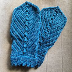 We hope to see some mitten-loving people knit all 12 mittens as part of the Year of Mittens, so today we're highlighting a couple prolific knitters on Ravelry who have been busy knittin' mittens!