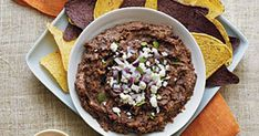 Black Bean Dip With Olive Oil, Diced Onion, Chili Powder, Ground Cumin, Fresh Lime Juice, Water, Fresh Oregano, Chipotle Chile, Salt, Black Beans, Queso Fresco, Red Onion, Chopped Fresh Cilantro, Corn Chips Black Bean Hummus, Black Bean Dip, Black Beans, Bean Dip Recipes, Snack Recipes, Snacks, Chipotle Chile, Corn Chips