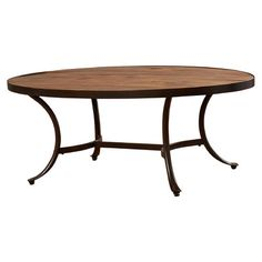 Oval wood and metal coffee table. Rustic farmhouse furniture.