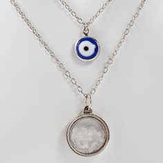 The salt is for purity, the evil eye is for protection on this charmed and charming two-in-one pendant necklace.