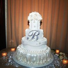 Monogram Cake Topper on a Cake Boss cake! Stunning! Single Monogram Cake Topper by CoutureCakeToppers on Etsy, $114.00 #couturecakejewelry #swarovski #weddingcaketopper