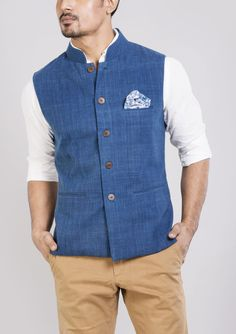 Buy Khadi Indigo Sleeveless Jacket for Men in India at low price – Shop Khadi ( Hand Spun and Woven) Jacket in Cotton - Bunosilo.com This simple yet detailed jacket is perfect for winter evenings. *Cotton indigo dyed khadi jacket with hand block printed cotton lining *3 inserted pocket *blue block printed cotton pocket square *sleeveless jacket *wooden buttons