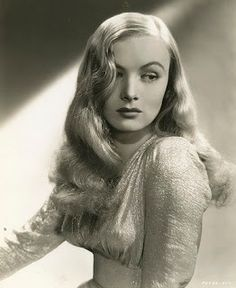 Veronica Lake- waves in hair, side part, arched filled-in eyebrows + lipstick
