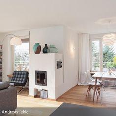 Der Ofen Dient Als Wärmequelle Und Ist Mittelpunkt Des Gesamten Raumes Ein  Nachträglich Eingesetztes Fenster Bietet