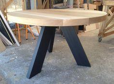 American Oak round dining table with Black angled legs  #customtimberfurniture #rounddiningtable #americanoak http://www.bomboracustomfurniture.com.au/dining-tables#/dining-tables/custom-dining-tables/