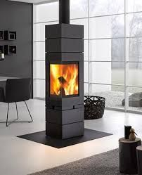 Designed by Professor Wulf Schneider, the unique and incredibly versatile Elements Stove System from Skantherm consists of only 3 elements. Using a special magnetic technology, Read House Architecture Design, Ambience Lighting, Wood Fireplace, Fireplace Design, Stove Heater, Stove, Fireplace, Pellet Stove, Wood Stove