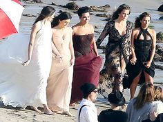 (Left) Kendall, Kylie, and Kris Jenner and Khloe and Kim Kardashian dress up in gowns for a family photoshoot on Nov. 4, 2013 in Malibu, Calif.