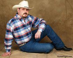 a gay bisexual cowboy daddybear wearing jeans
