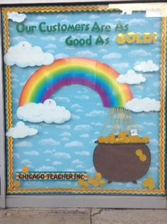 "We created our own cauldron, with gold ""coins"" made out of border. The rainbow is a part of the Carson Dellosa bulletin board set."