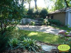 Small St Paul Back Yard. Natural stone wall and a paver patio with just the right amount of lawn.