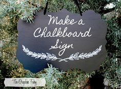 Make a chalkboard sign with a White Paint Pen. Printable Wreath is included on the #Tutorial.