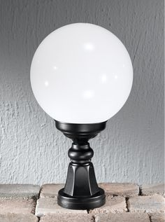 EXT6592 Rotondo Italian small pedestal post, black aluminium Italian die-cast aluminium matt black exterior fitting with opal polycarbonate spheres. Height- 450mm Diameter- 250mm BRAND- Franklite REFERENCE- EXT6592 DISPATCH- 1-2 Days (subject to availiability)