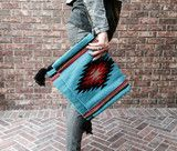 These bags have an edgy boho vibe and can be worn as a clutch, cross body, or over your shoulder.  *BRAIDED STRAP  *FLAP OPENING  *14X11 Coachella, tote, clutch, aztec, tribal, fringe, music festival